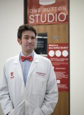 Dr. Luke Johnson standing outside THE Studio in the Eccles Health Sciences Library