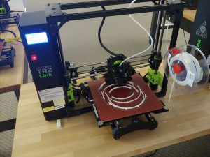 3D printer with white plastic structures